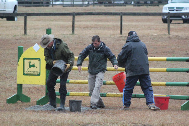 Grounds crew members keeping a show jump course safe. Photo by Samantha Clark.