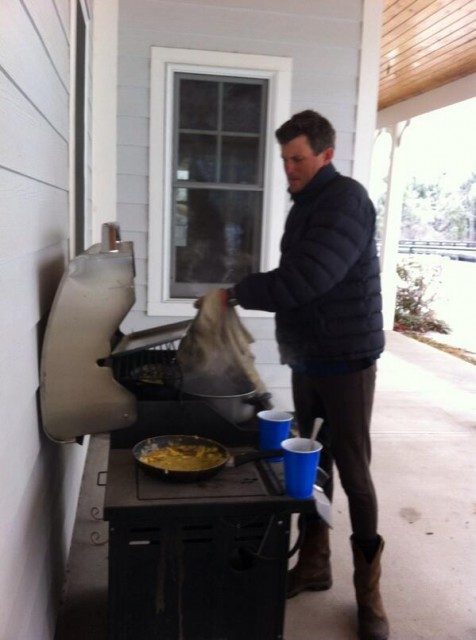 Breakfast of Champions. Boyd using the grill to make eggs and instant coffee due to lack of power at Bridle Creek. Photo from Silliman Eventing's Twitter feed (@CSEventing)