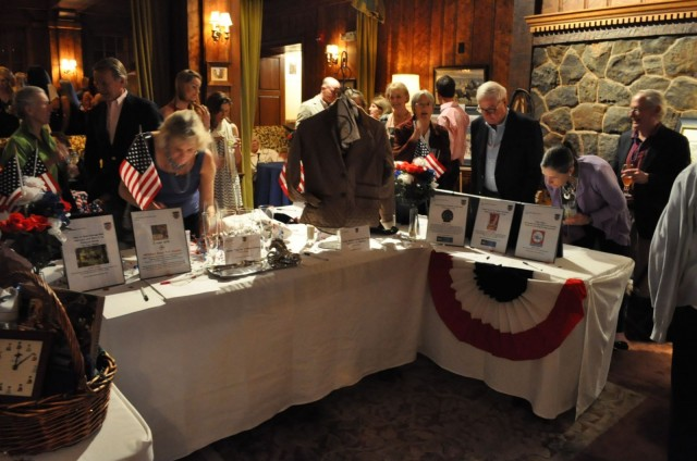 Party goers peruse the silent auction table at the Olympic Gala.