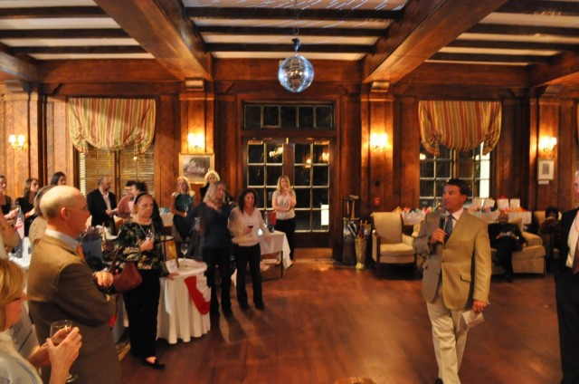 Coach DOC gives a rousing speech underneath a disco ball at The Willcox Hotel in Aiken. Photo by Kate Samuels.