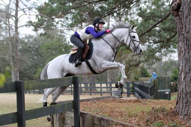 Rosie and her OTTB, Sugar, schooling cross country. Photo courtesy of Equisponse.