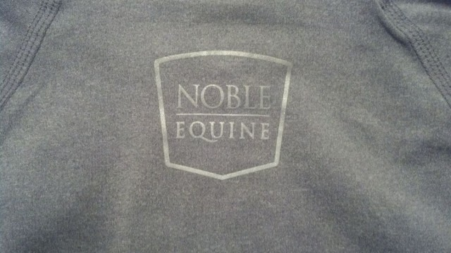 Reflective Noble Equine logo, located between the shoulder blades