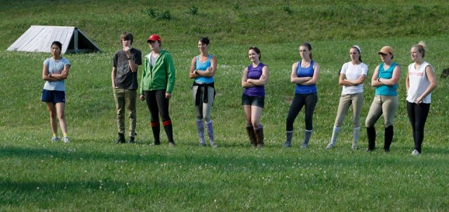 Several working students watching a cross-country school in 2012. Photo taken by Denny Emerson