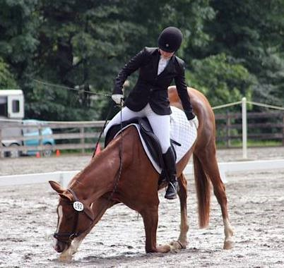 Joa and her horse, Kestral, always take a bow after their dressage tests. Photo by Chris Chakas.