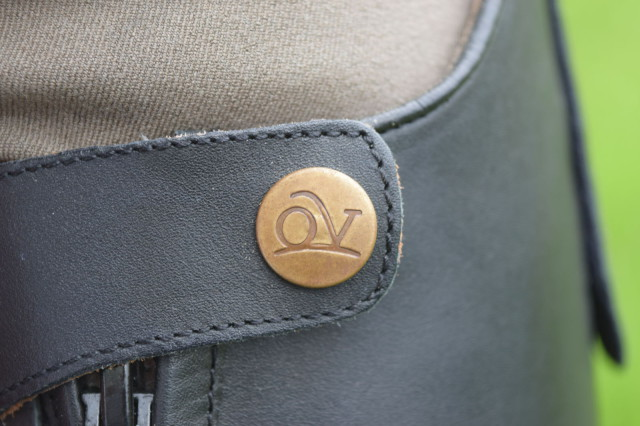 Button with abbreviated Ovation logo at top of Flex Field Boot