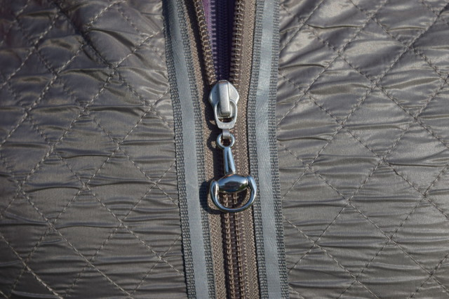 I'm always a fan of the details...the snaffle bit zipper pulls are quite lovely.