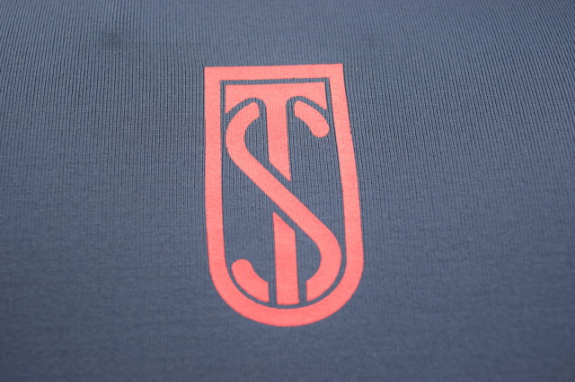 Tredstep Logo on back of shoulders on Futura Sport Top