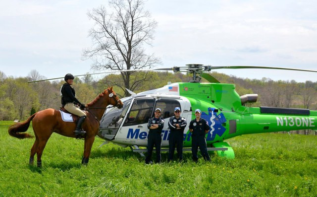 Julie McElhaney with her young CANTER prospect Scappare  hang out with the chopper and crew.  Photo from Jackie Smith.