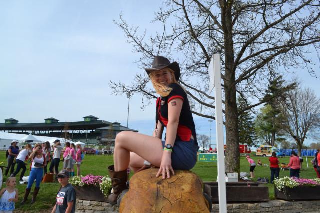 Merida Miller rocks boots, tatt & hat