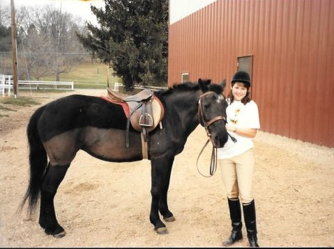 This is me as a freshman at Smith, with Tara, the elderly black pony who was my next teacher. And yes, I wore my helmet like that.