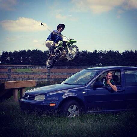 Why yes, that is Dom Schramm jumping a car with his motorbike. And yes, he did totally eat it upon landing.