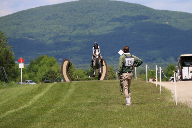 Ryan Wood waits for Caitlin Silliman at the finish line of the CCI3* XC at Bromont. Photo by Leslie Wylie.