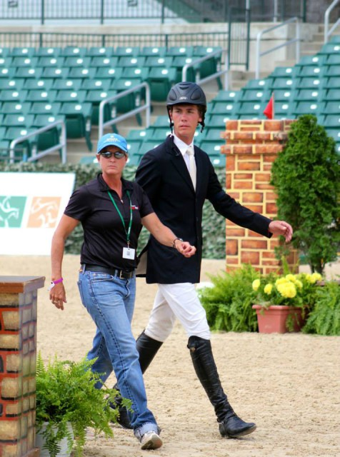 Games faces on! Coach Missy Ransehousen walks the Young Riders course with David Ziegler. Photo by Samantha Clark for PRO.