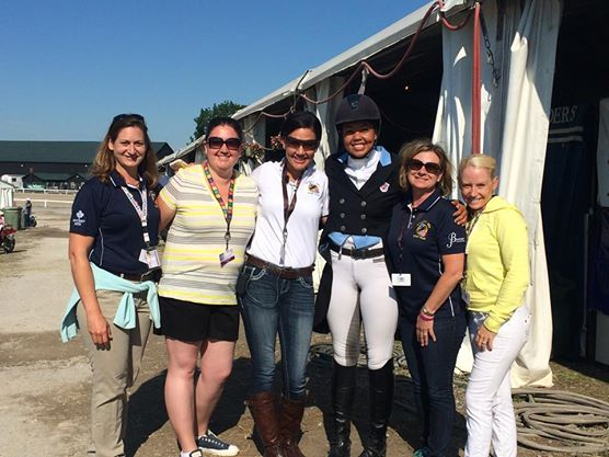 Kaylawna Smith celebrates her dressage win. Photo via Tamie Smith's Facebook page.