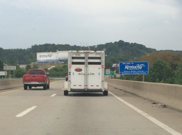 "Obligatory picture of my pony's horse trailer (lovingly referred to as the ""Eventing School Bus"") crossing into Kentucky."