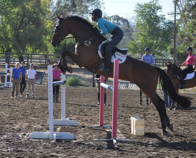 Kaylawna Smith riding in a Buck Davidson clinic last week for her final prep. Photo courtesy of Tamie Smith.