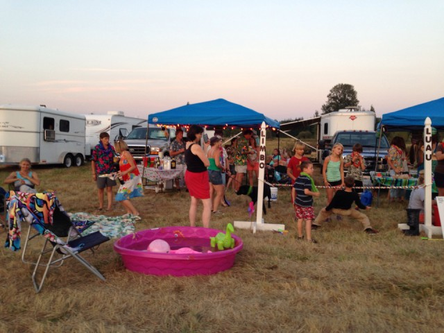 Nothing more fitting than a tropical luau amidst the horse trailers. Photo by Terri Niles.