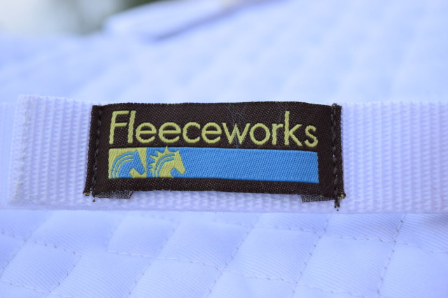 Fleeceworks logo on strap of Therawool Dressage Square Pad - Photo by Lorraine Peachey