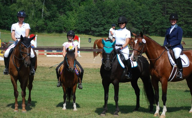 Ingvill Ramberg (Johnny's Private Collection), Maia Ramberg (Try N Catch Me), Lindsey Kahn (Kells Accent On Xcellence), and Deah Szymanski (Double Martini) at Otter Creek Summer HT. Photo by Jackie Metelak