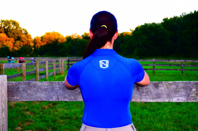 I personally think that the Noble Outfitters logo adds style points to the Riley polo; AND I also like the reflective properties for when I ride at dawn or dusk - Photo by Lorraine Peachey