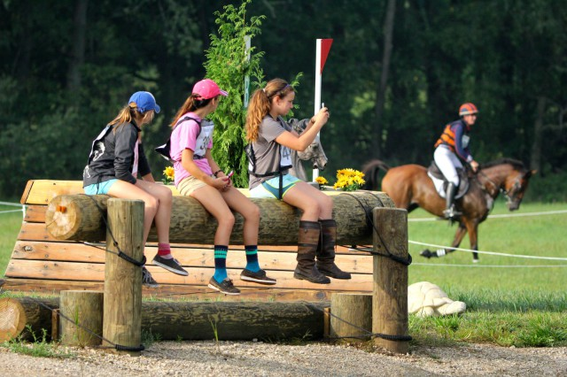 Spectators watch Lauren Keiffer gallop by. Photo by Rare Air Eventing Photography.