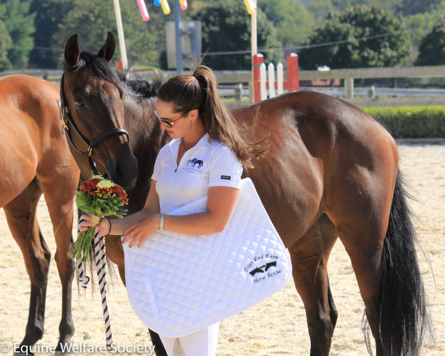 Checking out her prizes. Photo courtesy of Equine Welfare Society.