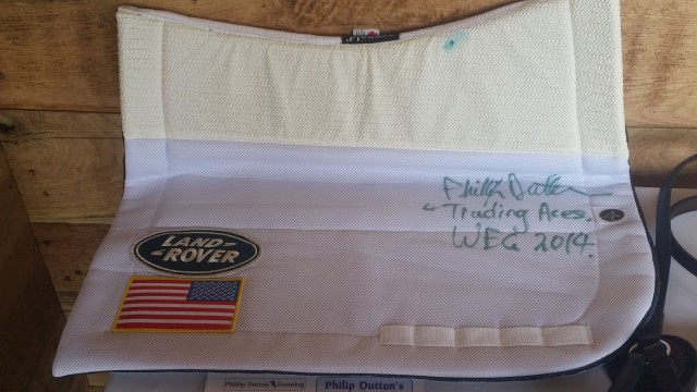 The lucky winner of the Phillip Dutton autographed pad that was used on Trading Aces at the 2014 WEGs may face a dilemma...to use the pad, or not use the pad!