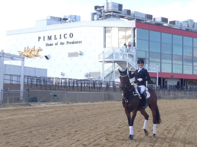 Lainey Ashker and her iron horse Anthony Patch just hanging out together in front of the Pimlico grandstand. No biggie. Photo via Lainey Ashker FB Page.