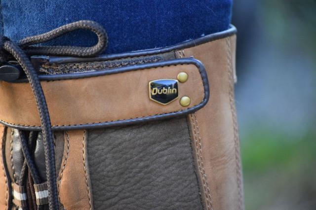 Logo accompanied by stylish bronze rivets on Dublin Harrowed Boots - Photo by: Lorraine Peachey