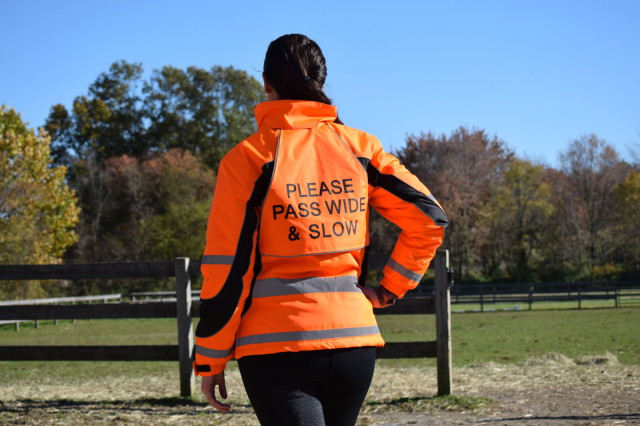 And for riders who want to wear their high visibility gear while riding near a road, there is also a triangle that you can attach to the back of the Aspey Jacket that reads 'Pass Wide and Slow' - Photo by: Lorraine Peachey