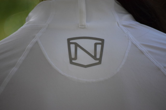Reflective Noble logo behind the shoulders on the Amy Quarter Zip Short Sleeve  - Photo by Lorraine Peachey