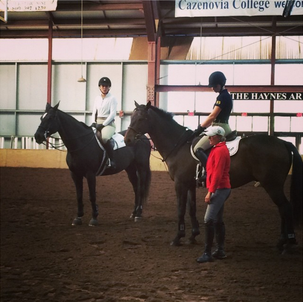 Marcia Kulak teaching two Cazenovia College Students in the first group  Photo courtesy of Cazenovia College Equestrian Team Facebook Page.