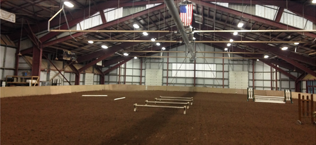 A set up of the ring which illustrates four cavaletti, two poles, and two jumps. Photo courtesy of Haley Bell.