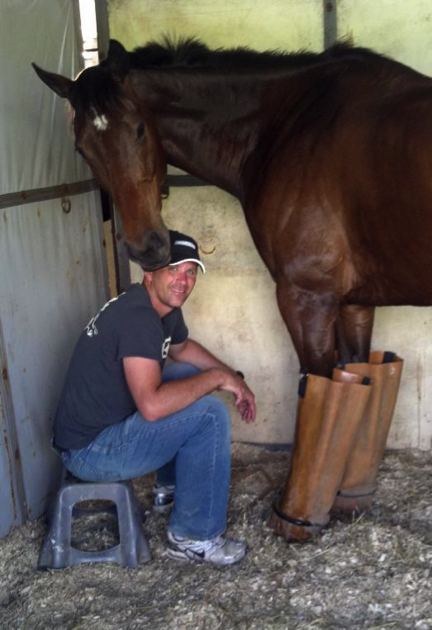Seth icing Hobbs after a double-clear CCI* cross country run at Bromont in June 2012.