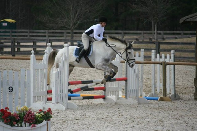 This is me and my Ollie on our first Beginner Novice course ever, and typical for us: me with a terrified look, and Ollie knocking down a rail on an oxer that is NOT 2'10