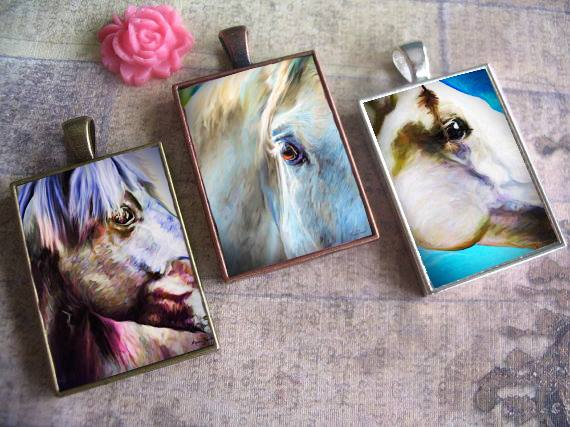 Horses of Us pendants.