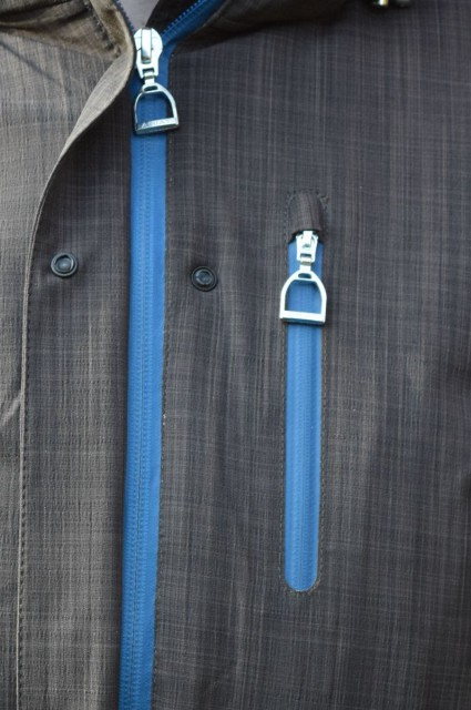 The Highland Jacket features two side pockets that zip shut, as well as one on the left chest. What's more are the little details--each of the zipper pulls are actually a small stirrup iron! - Photo by Lorraine Peachey