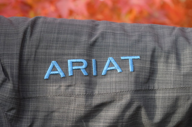 The Highland Jacket also has an attractive 'Ariat' logo embroidered in deep aqua blue along the left sleeve - Photo by Lorraine Peachey