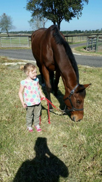 Riley, super groom Kathleen Blauth-Murray's daughter, and Reggie. Photo courtesy of Buck Davidson.