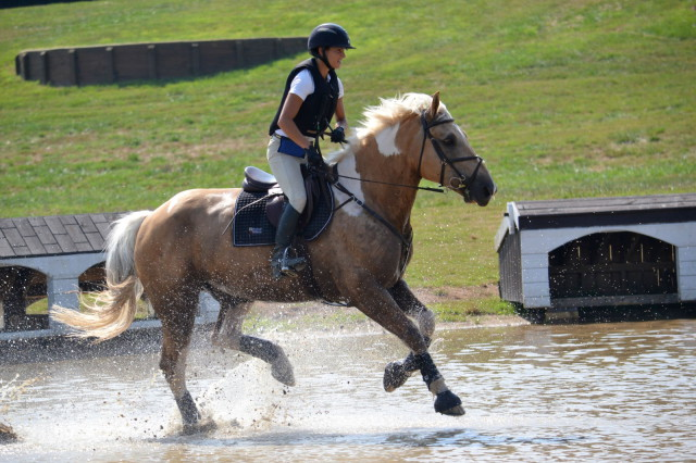 Splashing it up on XC? Not a big deal for s smartphone in a GoVelope Photo of Lauren Eckardt and Big Rich Texas provided by Giddup Gear