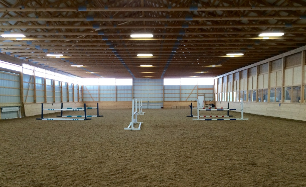 The setup of the ring for the clinic for all three groups. Heights of the jumps were different for each group (2',  2'6, and 3'). Photo courtesy of Danielle Zandirad.