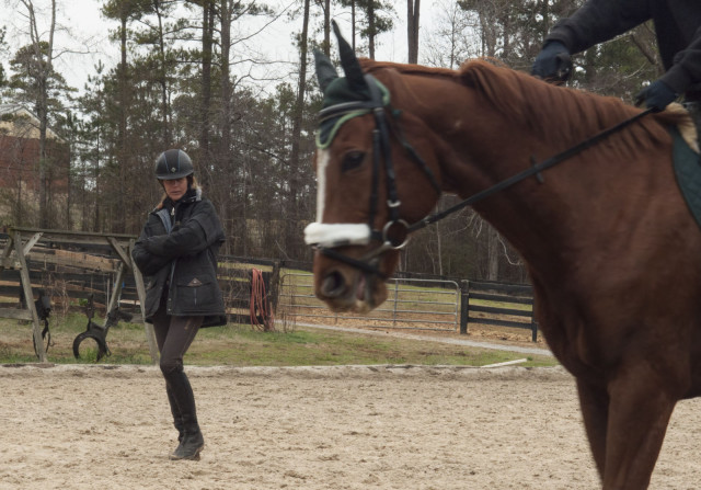 Julie works with a student in the dressage ring. Photo by Leslie Threlkeld