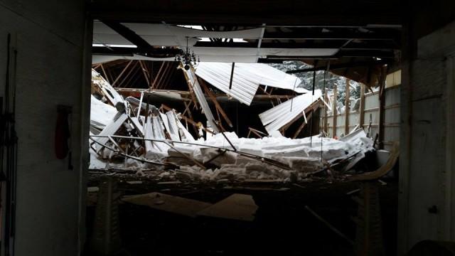 The view of the collapse from inside the barn. Photo via Flying High Stables Facebook