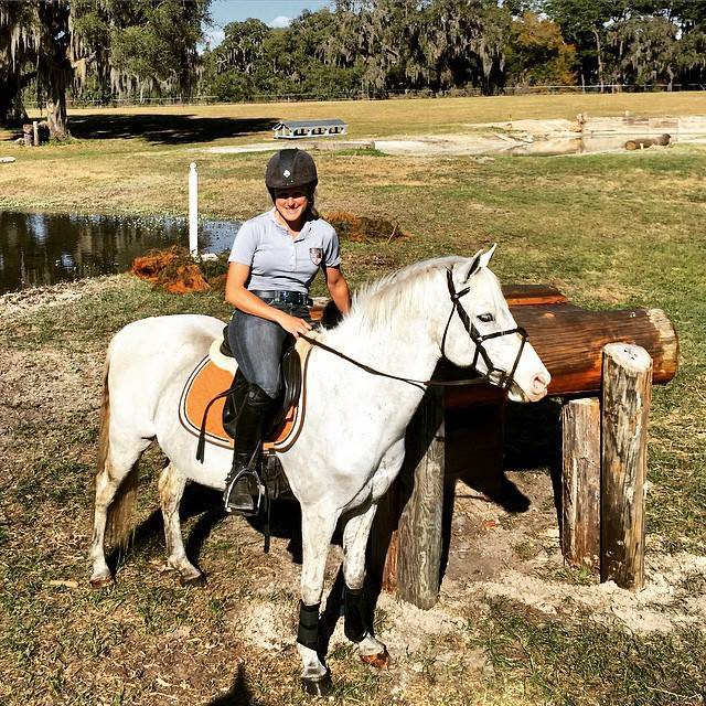 Justine Dutton will be jumping the Advanced table in the background...but not on super pony Merrylegs! Photo via Justine Dutton's Facebook.