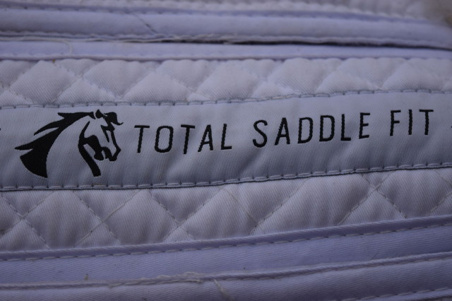 Logo along the spine of the Total Saddle Fit Sheepskin Half Pad with Wither Freedom Technology - Photo by Lorraine Peachey
