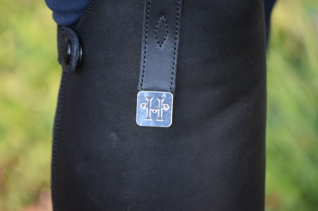 There is also a lovely tab at the top of the boot that features an elegant looking silver colored pendant with the Huntley Equestrian logo - Photo by Lorraine Peachey
