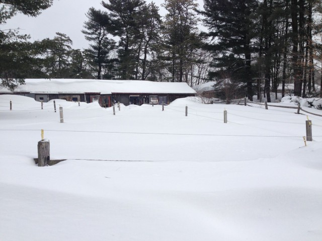 My barn on February 15th (four snowstorms in.) That's a four foot high fence in front.
