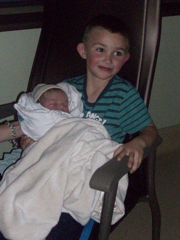 Big brother Jacob with his new sister. Photo via Jessica Phoenix on Facebook.
