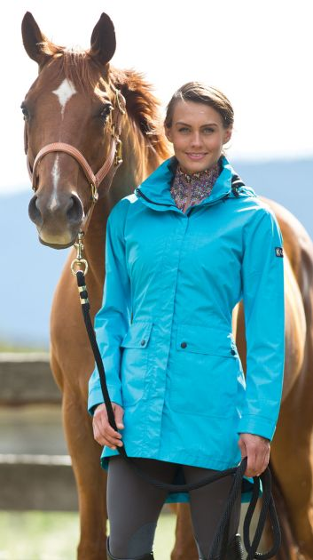 The Split Tail Rain Jacket — able to go from the ground to the saddle, just like that. Photo courtesy of Kerrits.