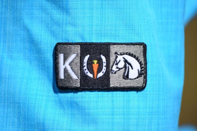 Kerrits logo patch on the left sleeve Split Tail Rain Jacket. Photo by Lorraine Peachey.